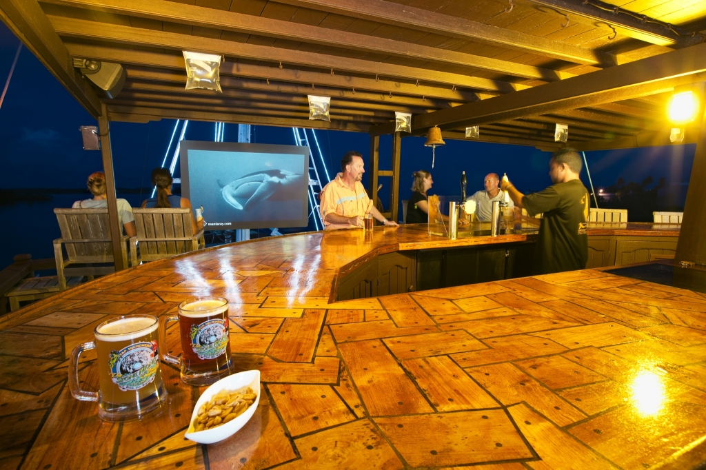 Mnew Restaurant - old wooden sailing vessel.  Manta Ray Bay Resort