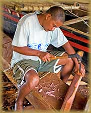 Yap traditional navigator building a canoe
